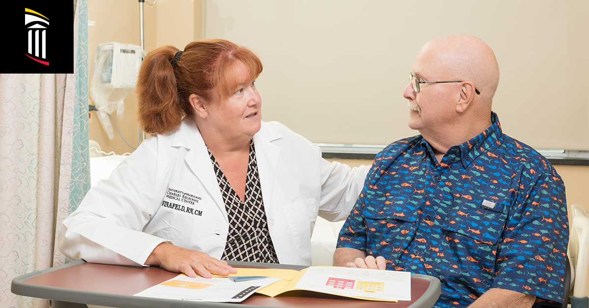 Photo of case manager guiding patient through medical documentation