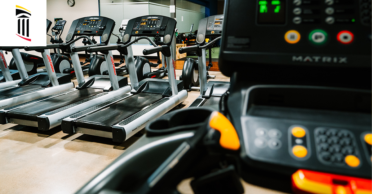 Line of treadmills in a gym space